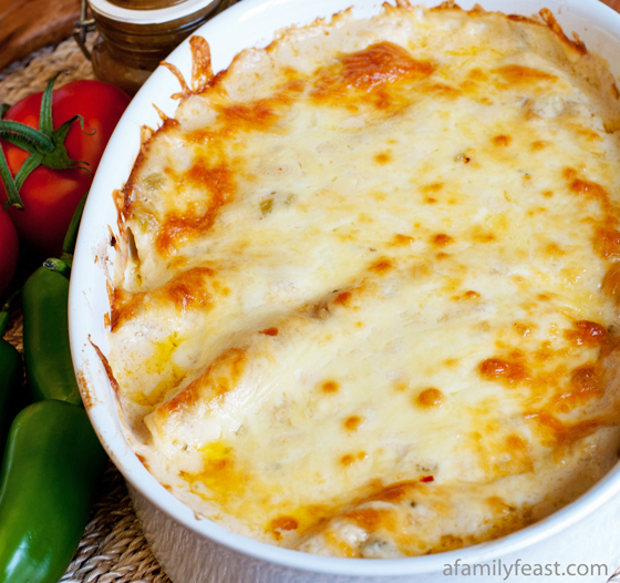 A delicious recipe for Chicken Enchiladas with a creamy White Sauce.
