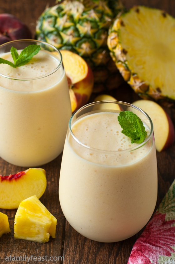 A light and delicious fresh pineapple peach smoothie made with non-fat Greek Yogurt and milk. So good!
